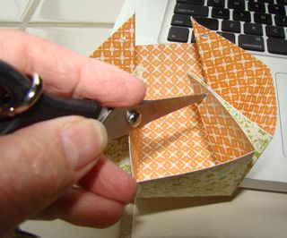 5-carefully punch holes in corners